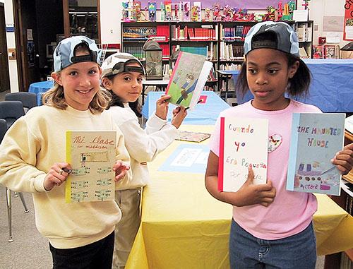 Author Dorros Author Visits - Three Girls Holding Books